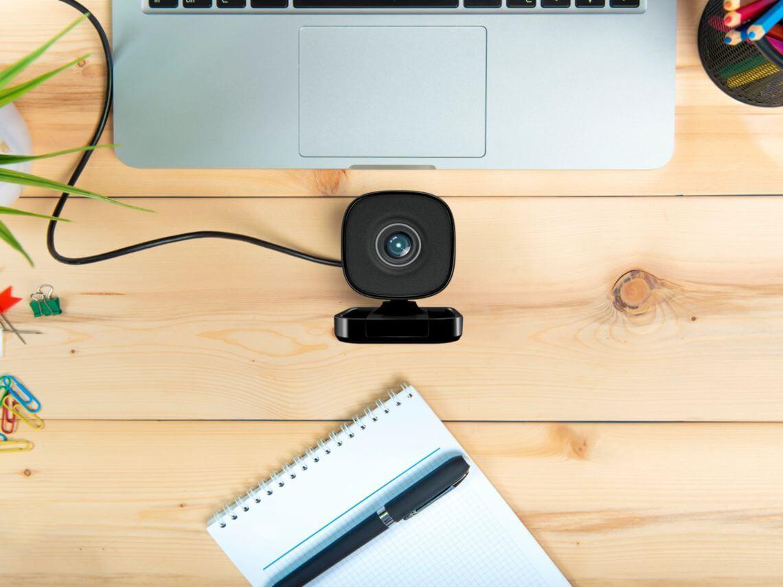 A desk with a laptop and webcam cloud